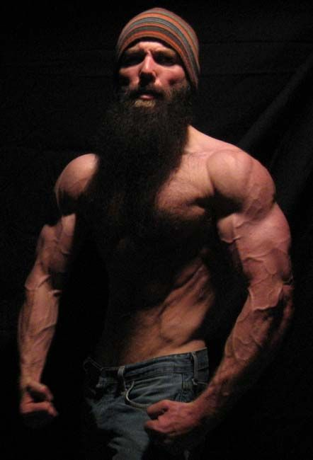 Long Hair Muscular Guy Beard And Rochester With